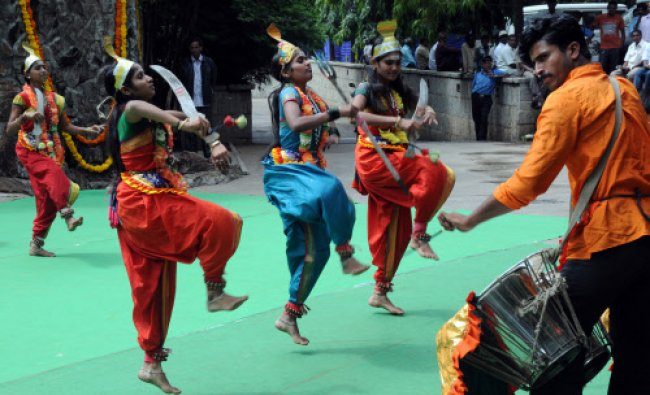 Folk artist perform on the occation Kempe Gowda Day celebration by BBMP in Bangalore on Saturday.