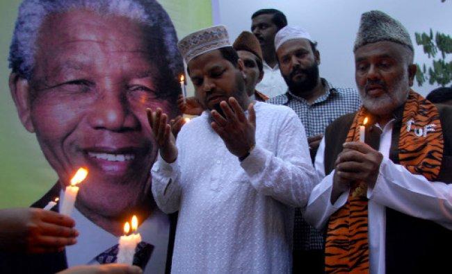 Dr Nelson Mandela Abhimanigala Vedike members holding a candle light prayer for Dr Nelson Mandela...