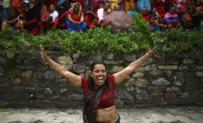 A woman sings and dances during Asar Pandra festival in Bhaktapur June 29, 2013.