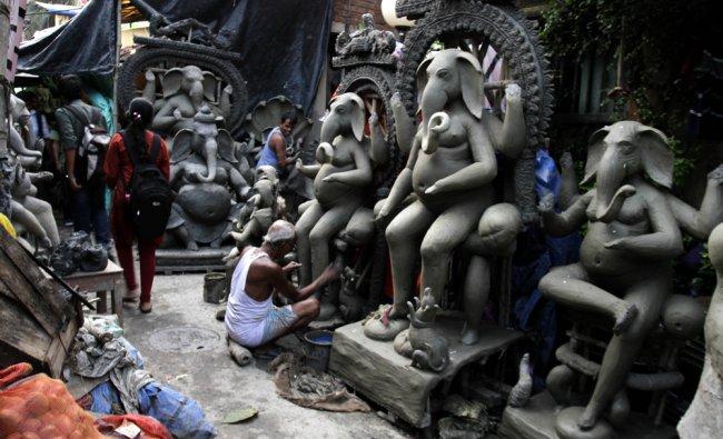 Artisans make clay idols of God Ganesha ahead of the Ganesh Chaturthi