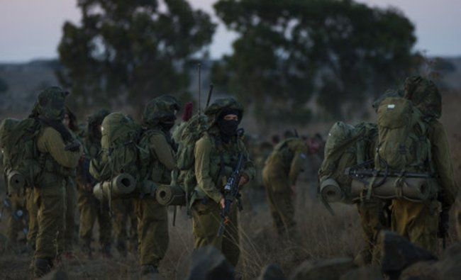 Israeli soldiers take part in a drill in the Golan Heights