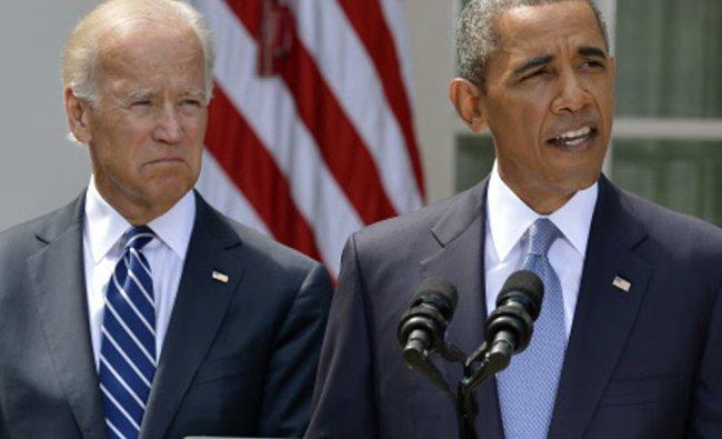 U.S. President Obama speaks about Syria next to Vice President Biden at the Rose Garden