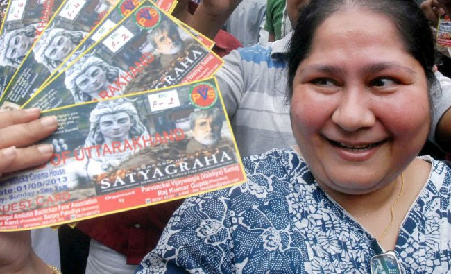 An Amitabh Bachchan fan displays her tickets of a special show of \'Satyagraha\'