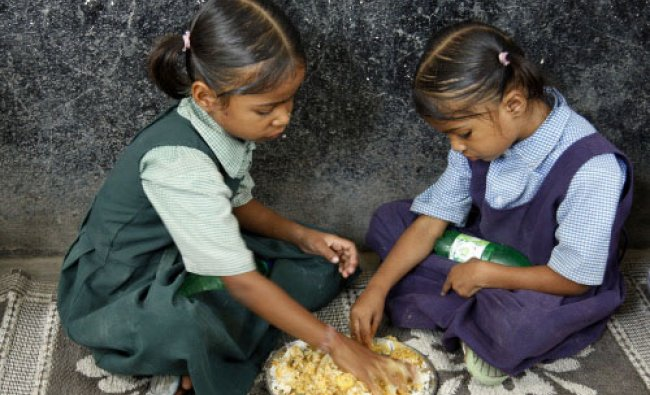 Schoolgirls eat a midday meal provided free at a government school in Hyderabad