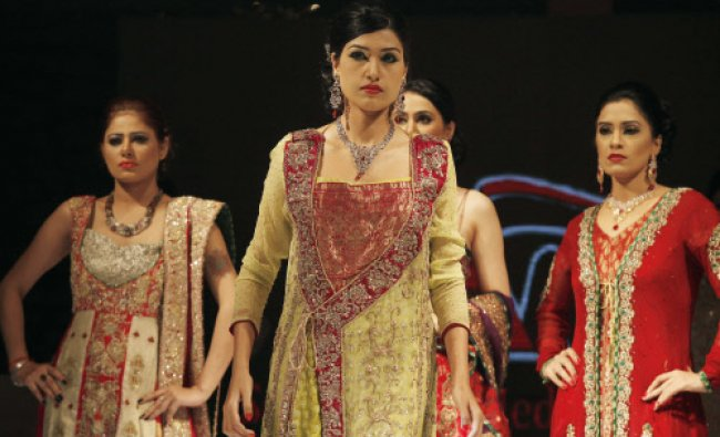 Models present jewellery creations from Riaz sons and dress designed by Mehar Khawar during the...