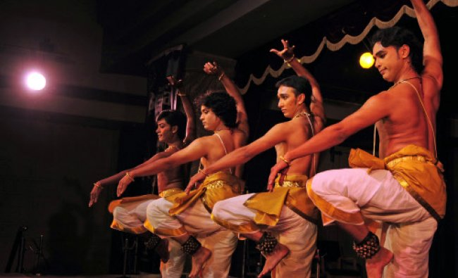 Artists of Tandava Troupe performing Bharatnatyam during the \'Soorya Festival 2013\' organised by...