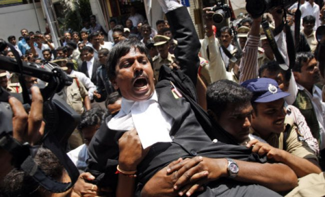Police detain lawyers during a protest against the move to carve out a new state