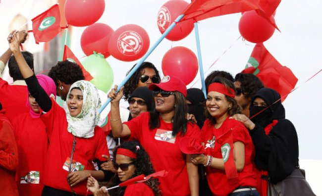 Supporters of presidential candidate Gasim Ibrahim cheer during a street march in Male