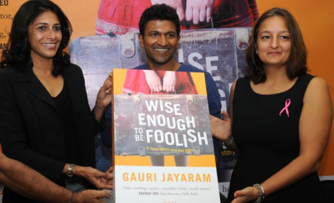 Kannada Film Actor Puneeth Rajkumar (right) during the launch of Wise Enough To Be Foolish