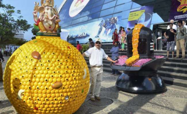 A \'Laddoo\' car with an idol of Lord Ganesh is unveiled in Hyderabad