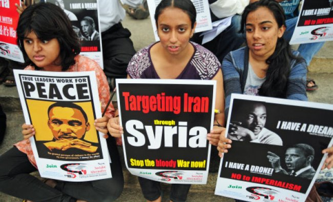 Members of People\'s Solidarity Concerns- Bangalore staged a protest against America\'s...