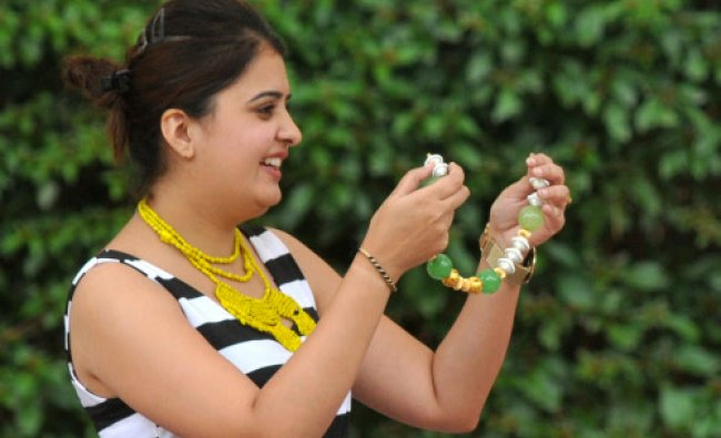 A woman arranges Jewels at Flea Sante in Windflower Resort in Mysore on Saturday. DH Photo