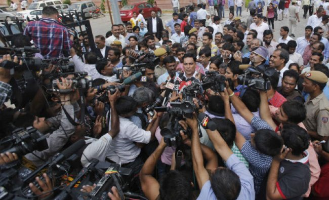 A.P. Singh speaks with the media after the verdict in New Delhi