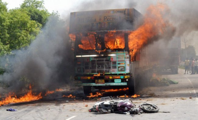 Irate villagers set a truck ablaze after it crushed to death a motorcyclist
