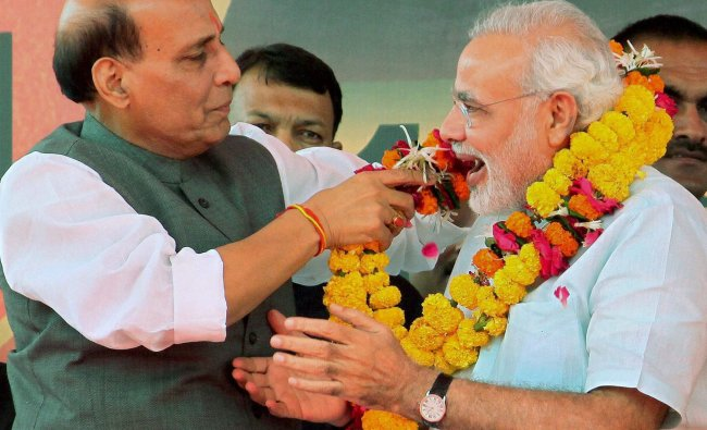 Gujarat Chief Minister Narendra Modi being greeted by the BJP President Rajnath Singh