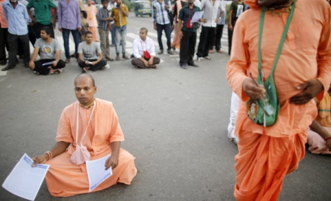 Hindu devotees take part in a protest as they block a street in Dhaka September 10, 2013.