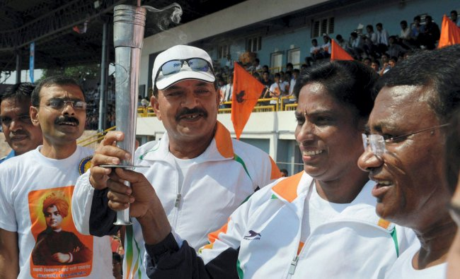 PT Usha with former cricketer Madanlal and former Hockey star Ashok Dhyanchand carrying \'torch ...