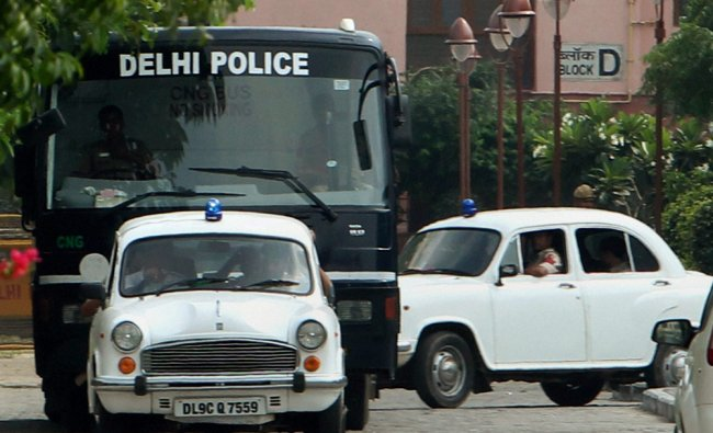 Four convicts of the Dec 16 Delhi bus gang rape case being taken to Saket court for sentence ...