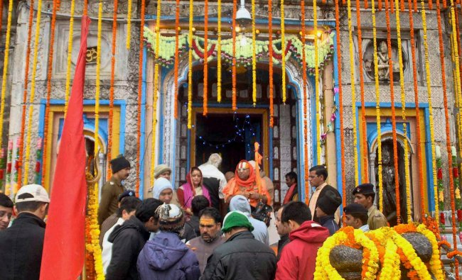 Priests along with temple committee members perform prayers at the Kedarnath temple in Uttarakhand .