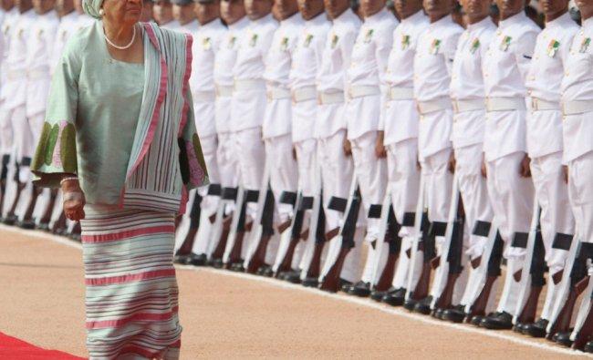 Liberian President Ellen Johnson Sirleaf inspects a guard of honor in New Delhi ...