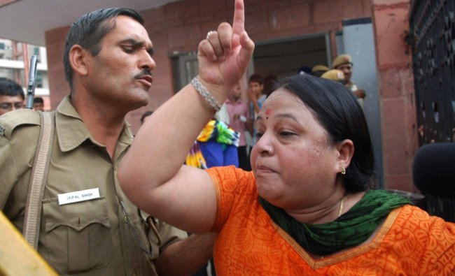 A protester shouts at Defence Lawyer A P Singh for defending a convict in the Dec 16 gang rape case