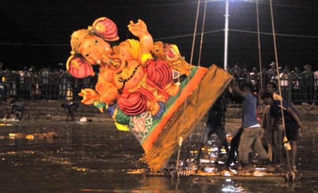 After Ganesha Chathurthi festival, BBMP volunteers immersed ganesha idols by a crane at Ulsoor ...