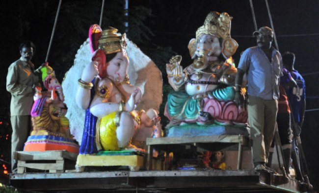 Ganesha idols immersed by a crane at Ulsoor lake after ganesha chathurthi festival in Bangalore...