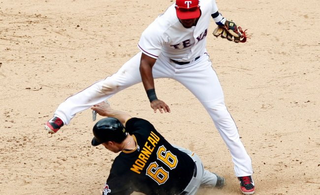 Pittsburgh Pirates\' Justin Morneau slides into second base to break up the double play as Texas...