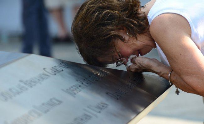 Geraldine Davie of Pelham, N.Y., cries after viewing name of her 23-year-old daughter, Amy...
