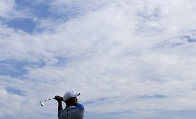 Tiger Woods of the U.S. watches his tee shot on the 17th hole during the Pro-Am round of the BMW...
