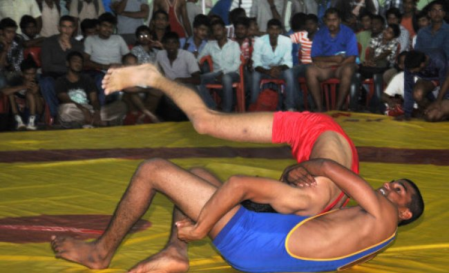 Students participate in Wrestling during Mysore University Inter Collegiate Competitions...