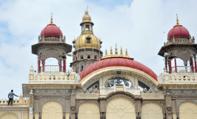 Painters busy with painting the Mysore Palace as dasara preparations are on full swing on Thursday,