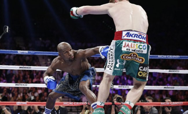 Floyd Mayweather Jr. throws a low jab against Canelo Alvarez in the first round during a 152...