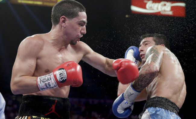 Danny Garcia lands a punch against Lucas Matthysse in the eighth round during a WBC and WBA super...