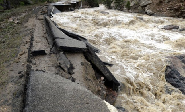 Lefthand Canyon Drive is in ruins seen here on Saturday, Sept. 14, on Olde Stage Road in Boulder...