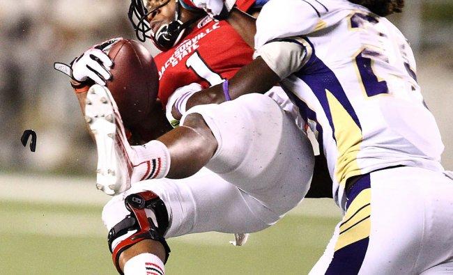 Jacksonville State wide receiver Markis Merrill, left, gets slammed by North Alabama defensive...