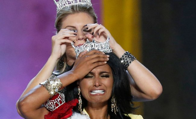 Miss America contestant, Miss New York Nina Davuluri reacts after being chosen winner of the 2014...