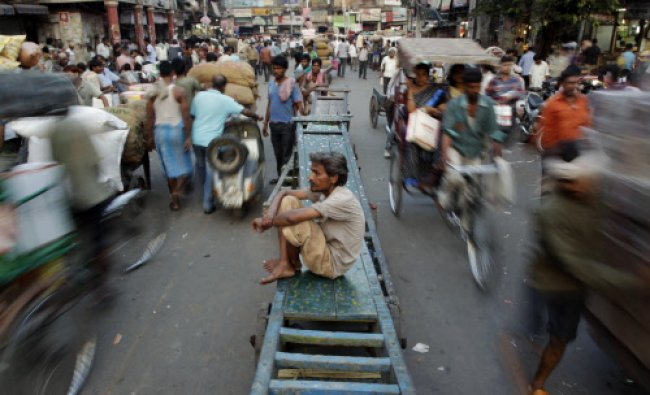 A laborer rests on a cart at the spice market in the old quarters of New Delhi, India, Monday...