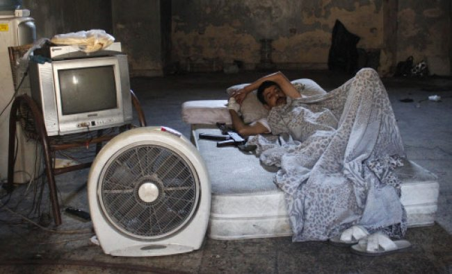 A Free Syrian Army fighter rests in the old city of Aleppo September 16, 2013.