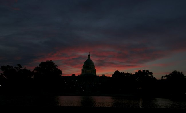 The U.S. Capitol Building in Washington is pictured before sunrise September 16, 2013. Stunned...