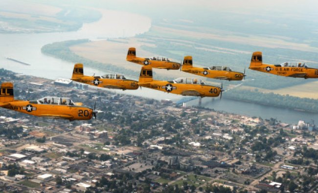 The Lima Lima Flight flies over downtown Owensboro, Ky. Thursday afternoon Sept. 19, 2013 during...