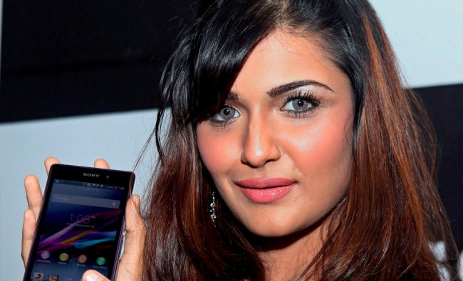 A model shows the latest product of Sony in Chennai on Friday...
