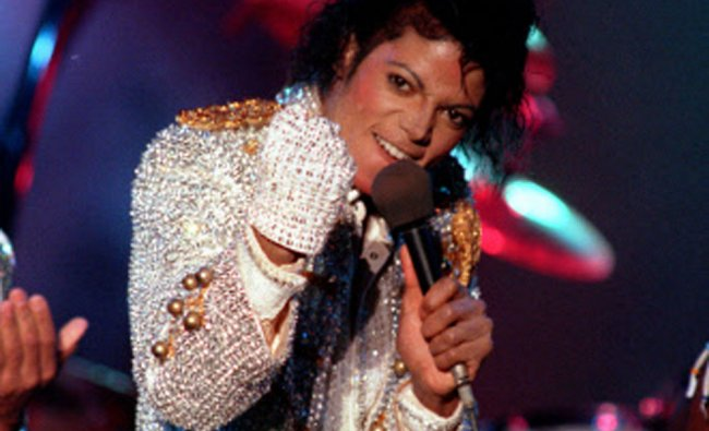 In this Dec. 3, 1984 photo, Michael Jackson performs with his brothers at Dodger Stadium in LA