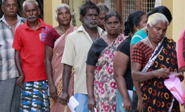 Sri Lankan ethnic Tamils wait to cast their votes at a polling station
