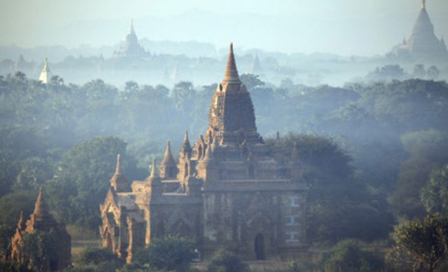 In this Aug. 15, 2013 photo, ancient temples stand at sunrise in Bagan, central Myanmar
