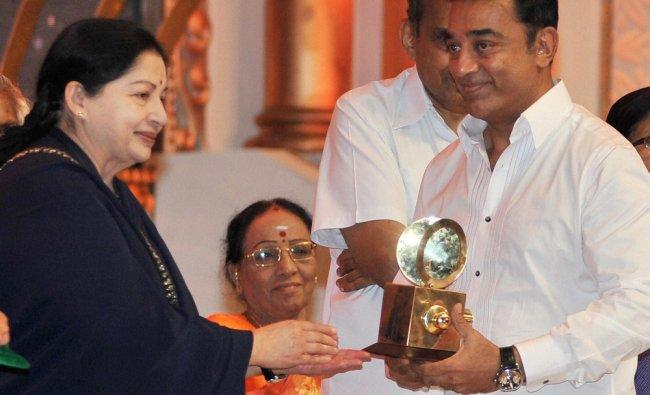 Tamil Nadu Chief Minister J Jayalalithaa presenting an award to actor Kamal Hasan during the...
