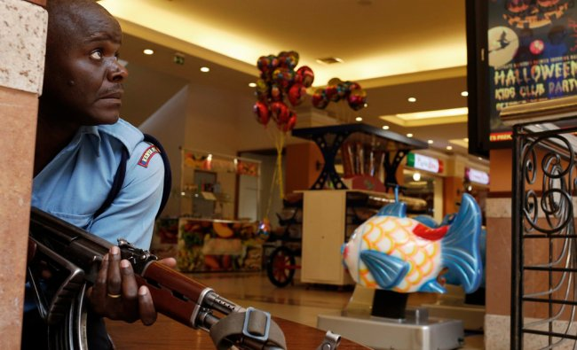 A police officer tries to secure an area inside the Westgate Shopping Centre where gunmen went on...