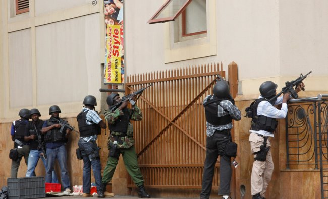 Armed special forces aim their weapons at the Westgate Mall in Nairobi, Kenya Saturday...