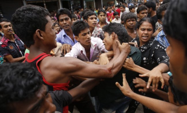 Garment workers clash with locals, who they believe are supporting the garment factory owners...