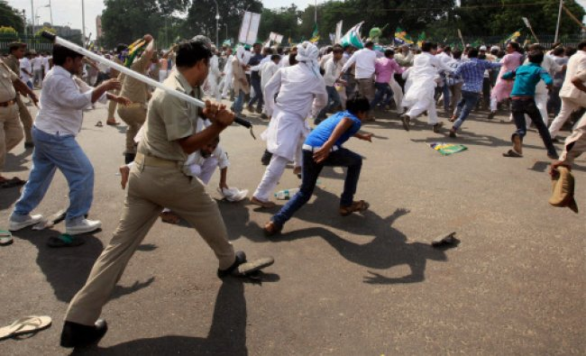 Policemen chasing away Peace Party activists protesting against Muzaffarnagar riots, in Lucknow...